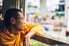 BANGKOK, THAILAND - JUNE 16: An unidentified monk looking out th Royalty Free Stock Images