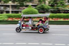 Driver and tourists in Tuk Tuk or Samlor royalty free stock image