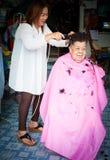BANGKOK THAILAND - JUNE 3, 2016 : Woman barber haircut to The Ol. D woman in Bangkok Thailand Royalty Free Stock Photo