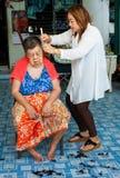 BANGKOK THAILAND - JUNE 3, 2016 : Woman barber haircut to The Ol. D woman in Bangkok Thailand Royalty Free Stock Image