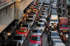 Bangkok, Thailand: Legendary Traffic Jams. Bumper-to-bumper traffic is the norm on busy Sathorn Road at rush hour with a mixture of cars, tuk-tuks, and Royalty Free Stock Photography