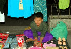 Bangkok, Thailand: Little Boy Selling on Street Royalty Free Stock Photos