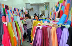 Bangkok, Thailand: Little India Fabric Shop. Customers and workers with hundreds of bolts of colourful fabrics including fine silks sold at a shop in the Indian Stock Images