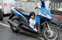 Bangkok,Thailand:  Little Thai Girl Seated on Motorcycle Stock Images