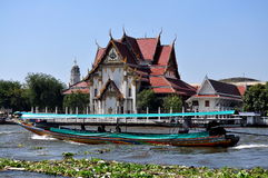 Bangkok, Thailand: Long Boat and Thai Temple Royalty Free Stock Image