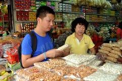 Bangkok, Thailand: Man Buying Cashew Nuts Stock Photography