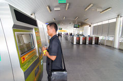 Bangkok, Thailand:Man buying tickets BRT bus Stock Photos