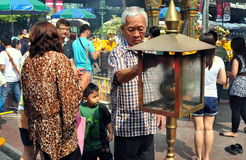 Bangkok, Thailand: Man at Erawan Shrine Royalty Free Stock Photos