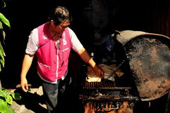 Bangkok, Thailand: Man Grilling Chicken Royalty Free Stock Photography