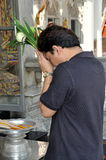Bangkok, Thailand: Man Praying at Temple Royalty Free Stock Photo