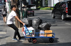 Bangkok, Thailand: Man Pulling Dolley Cart Stock Photography