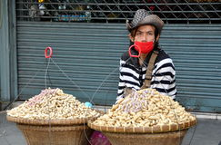 Bangkok, Thailand: Man Selling Peanuts Royalty Free Stock Photo