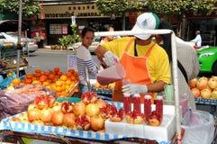 Bangkok, Thailand: Man Selling Pomegranate Juice Royalty Free Stock Images
