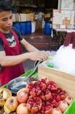 Bangkok, Thailand: Man Selling pomegranates juice Royalty Free Stock Photography