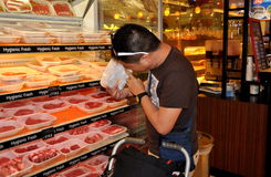 Bangkok, Thailand: Man Shopping for Meat in super market Stock Photo