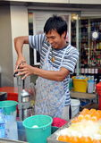 Bangkok, Thailand: Man Squeezing Oranges Royalty Free Stock Images