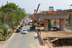Bangkok Thailand- Mar 2 2014: Builder team are building new sky train station on Local road, Bangkok, Thailand. Stock Image