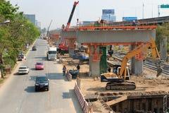 Bangkok Thailand- Mar 2 2014: Builder team are building new sky train station on Local road, Bangkok, Thailand. Stock Photos