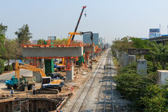 Bangkok Thailand- Mar 2 2014: Builder team are building new sky train station on Local road, Bangkok, Thailand. Stock Photography