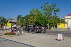 BANGKOK, THAILAND, MARCH 06, 2018: Outdoor view of unidentified people walking, and some transport, cars, and Royalty Free Stock Photo
