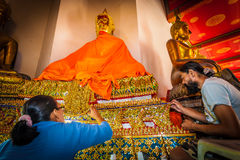 The artist repairing the ancient Buddha which over 200 years Royalty Free Stock Photo