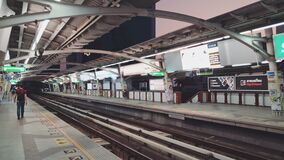 BANGKOK, THAILAND - MARCH 23, 2020: The Bangkok Airport Rail Link. Overground train airtrain. Walking through the empty