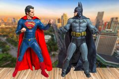 Bangkok, Thailand - March 30, 2016 : Batman and Superman figure with building in background. They are superheros from movie