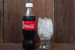 BANGKOK, THAILAND-MARCH 2, 2018 : Coca-Cola bottle with ice in g. Lass on vintage style background royalty free stock photography
