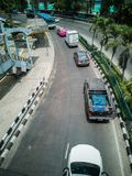 Curved road - Street view of Bangkok Metropolis, shooting from the top of an overpass. Bangkok / Thailand - March 20 2019: Curved road - Street view of Bangkok royalty free stock photo