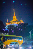 Bangkok, Thailand - March 2, 2017: The golden mount temple at ni. Ght with colorful light and traffic jam Stock Photography