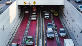 Traffic on Road at Kaset Kasetsart University Intersection Tunnel in bangkok, Thailand. Bangkok, Thailand - March 3, 2018: 4k Time-lapse of traffic on Road at stock video footage