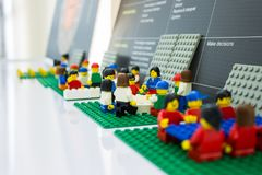 Lego business are meeting at office . teamwork are planning and working . close up on mini object .