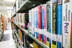 BANGKOK, THAILAND - MARCH 18, 2017: Many books were arranged on. The shelves during school holidays at Central Library King Mongkut`s University of Technology royalty free stock photo