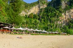 BANGKOK, THAILAND - MARCH, 26, 2018: Outdoor view of Huge mountains and people in the beach with some palm trees on Poda. Island in a gorgeous sunny day Royalty Free Stock Photo