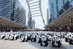 Bangkok, Thailand - March 8, 2016 : 1600 Pandas World Tour. In Thailand by WWF at Chong Nonsi BTS sky walk bridge. 1600 paper marche pandas are made from Stock Photography