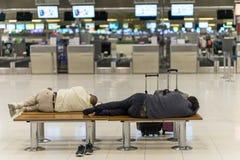 Bangkok, Thailand - march 1, 2016: People sleeping in night airport. Terminal Suvarnabhumi while waiting fly royalty free stock image