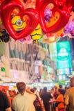 Bangkok, Thailand - March 2, 2017:  Street vendor is selling cut. E balloons at Khao San Road night market, Bangkok, Thailand Stock Image