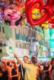 Bangkok, Thailand - March 2, 2017: Street vendor is selling cut. E balloons at Khao San Road night market, Bangkok, Thailand stock illustration