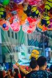 Bangkok, Thailand - March 2, 2017:  Street vendor is selling cut. E balloons at Khao San Road night market, Bangkok, Thailand Royalty Free Stock Photos