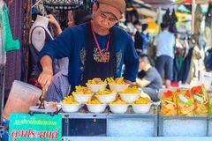 Bangkok, Thailand - March 18, 2017: Street vendor is selling raw Royalty Free Stock Photos