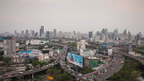 Bangkok, Thailand - March 25, 2016:Timelaps day to night Traffic on express way in Bangkok , Thailand. Timelaps day to night Traffic on express way in Bangkok stock footage