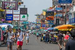 Tourists and backpackers walk on Khao San Road in Bangkok, Thailand. Khao San Road is a famous low budget hotels and guesthouses a Royalty Free Stock Image