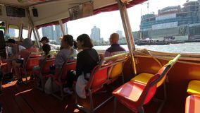 Bangkok, Thailand - March 5, 2018 : Travel on express boat, Chao Phraya river transport, Boat quickly rush along the river on high. Speed stock video