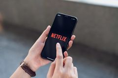 Bangkok, Thailand - March 06, 2019 : women use Netflix app on smartphone screen. Netflix is an international leading subscription service for watching TV stock images