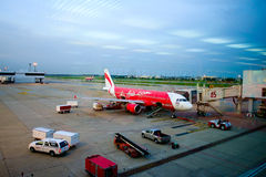 BANGKOK/THAILAND-MAY  16 : Air Asia aircraft docking at  Don Mue. AngInternational Airport on May 16, 2014. Don Muang is  the main hub for low cost airlines such Stock Photo