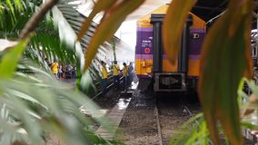 Bangkok, Thailand - May 25, 2019: An employee washes a railway passenger car at Hua Lamphong, A group of workers washes stock footage