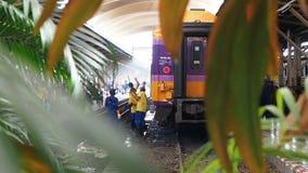 Bangkok, Thailand - May 25, 2019: An employee washes a railway passenger car at Hua Lamphong, A group of workers washes stock video footage