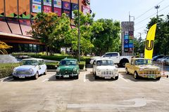 Four mini Austin car parking on the street - Vintage and Classic car concept stock image
