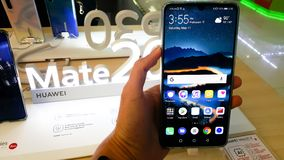 BANGKOK, THAILAND - MAY 11, 2019: Hands on Huawei Hate 20 Series that show welcome and features screen of the smartphone in retail. BANGKOK, THAILAND - MAY 11 royalty free stock photography
