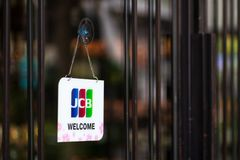 Bangkok, Thailand - May 26, 2019: JCB credit cards and welcome sign hangs in front of a shopping store in in Bangkok, Thailand. JCB is a credit card company stock photos